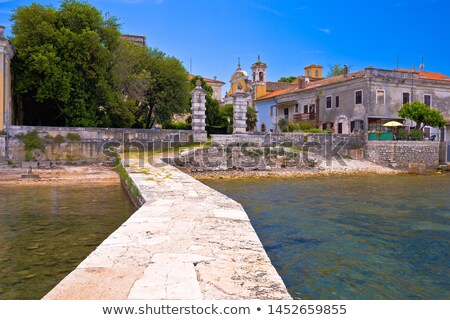 Dajla abandoned convent coastline view from pier Stock photo © xbrchx