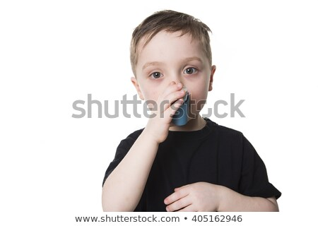 boy 4 years old inhales himself on a white background stock photo © lopolo