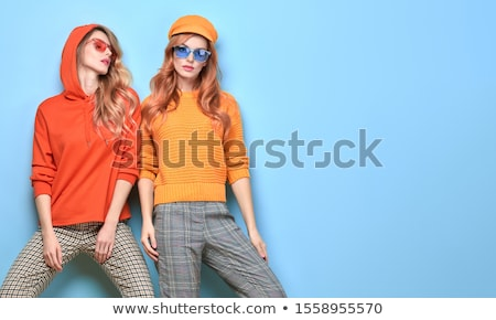 Stylish shopping girl. Fashionable woman in yellow pants and short white t-shirt. Shopping bags in h Stock photo © user_10144511