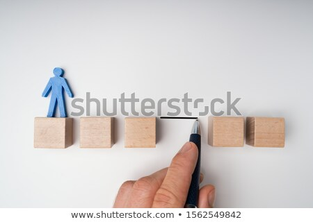 Human Hand Filling Gap Between Wooden Blocks Stock photo © AndreyPopov