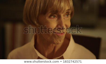 Happy mature female with glass of wine making festive toast by served table Stock photo © pressmaster