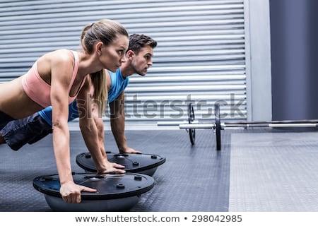 Kobieta fitness mężczyzn zdrowia klub strona deska Zdjęcia stock © Kzenon