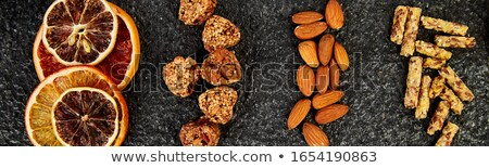 Banner of Healthy snacks - variety oat granola bar, rice crips, almond, dried orange Stock photo © Illia
