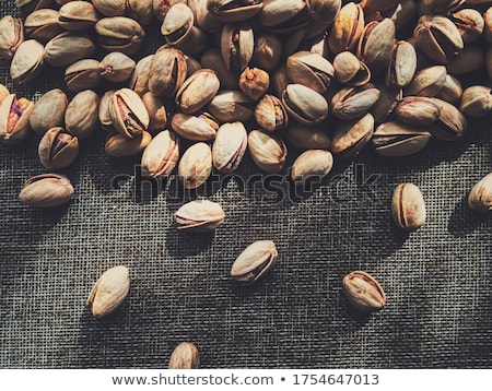 Pistachio nuts on rustic linen background Stock photo © Anneleven
