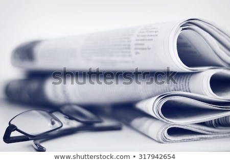 news paper with lens Stock photo © get4net