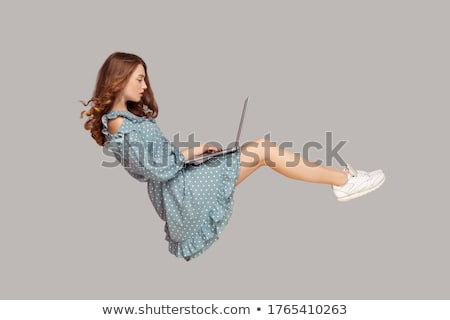 Woman typing on a laptop in mid-air Stock photo © photography33