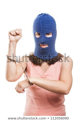 Woman in balaclava showing handcuffs on hands Stock photo © ia_64