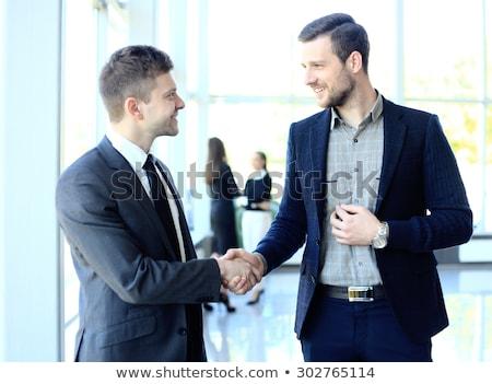 Vriendelijk zakenman handdruk foto aantrekkelijk laat Stockfoto © sumners