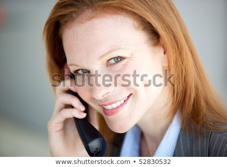 Self-assured business woman taking a call Stock photo © wavebreak_media