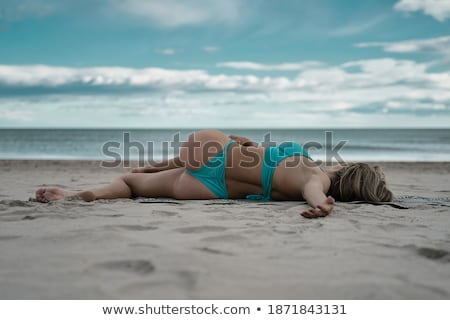curly blonde posing in bikini stock photo © carlodapino