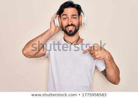 retrato · feliz · enérgico · homem · escuta - foto stock © konradbak