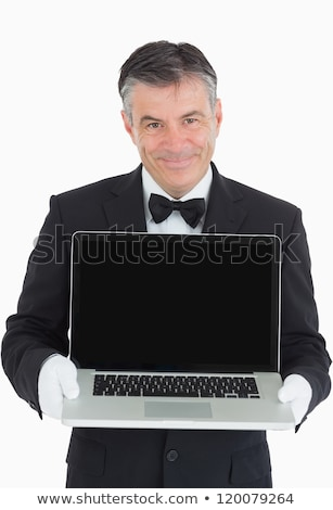 Waiter showing us something on a laptop in front of camera Stock photo © wavebreak_media