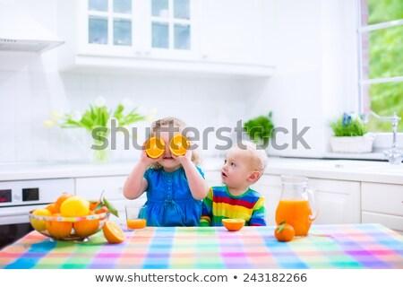Little girl with freshly squeezed orange juice Stock photo © photography33