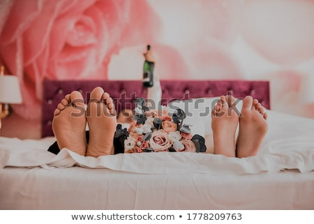 Young couple in love with pink rose in between them  Stock photo © tab62
