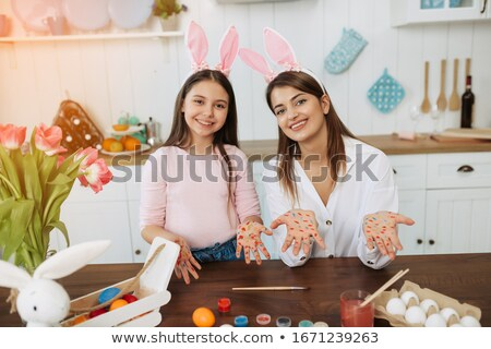 kid showing painted hands to camera stock photo © stockyimages
