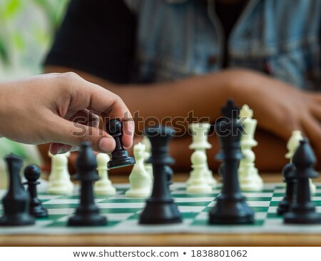 hand holding a green pawn stock photo © michaklootwijk