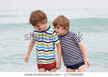cute · ragazzo · divertimento · stormy · spiaggia · sorriso - foto d'archivio © meinzahn