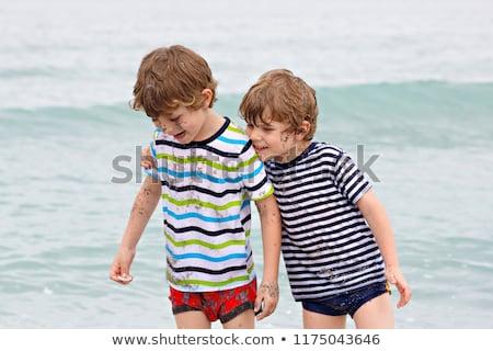 boy has fun in the stormy beach Stock photo © meinzahn