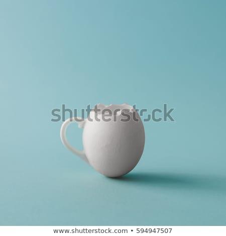Húsvéti tojások porcelán csésze húsvét virágok étel Stock fotó © Sandralise