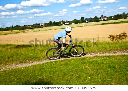 boy racing with his bike in open area Stock photo © meinzahn