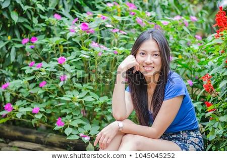 Güzel kız yeşil bambu arkasında gülümseme Stok fotoğraf © Nobilior