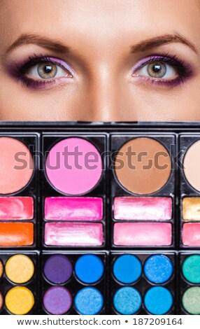 Closeup of beautiful womanish eyes with makeup kit Stock photo © vlad_star