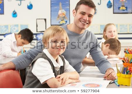 Group Of Primary Schoolchildren And Teacher Having lesson In Cla Stock photo © monkey_business