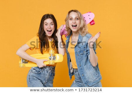 Stock photo: Girl wearing sport clothes extremely surprised