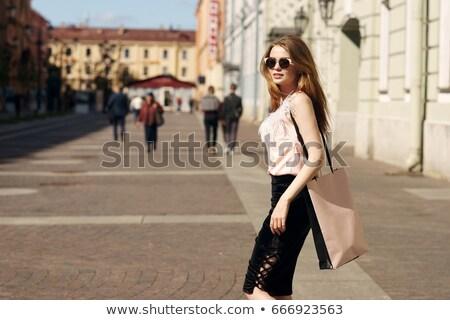 Mulher vermelho blusa preto saia Foto stock © gromovataya
