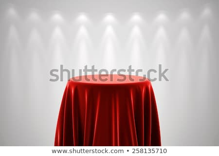 round pedestal with white silk cloth and spot lights stock photo © creisinger