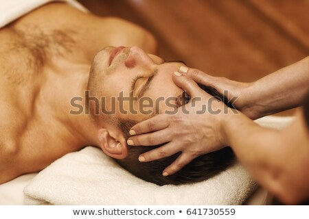 man receiving head massage at spa center stock photo © wavebreak_media