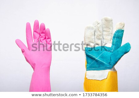 mans hand in rubber glove with sponge isolated stock photo © michaklootwijk