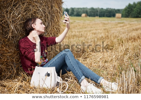 young attractive playful women near hay stacks stock photo © aikon