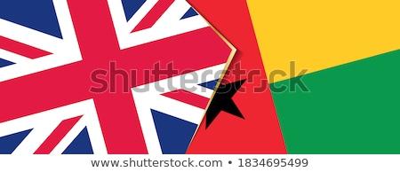 Stock photo: United Kingdom and Guinea Flags