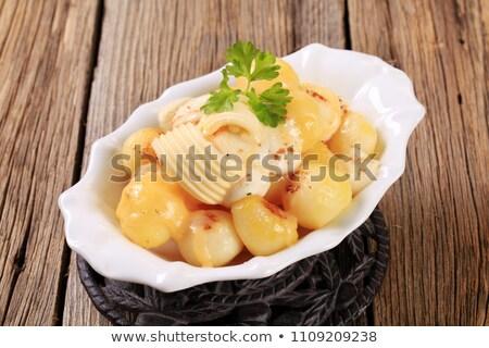 Parisian potatoes with mozzarella cheese Stock photo © Digifoodstock