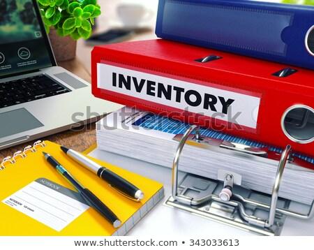 inventory on red ring binder blurred toned image stock photo © tashatuvango