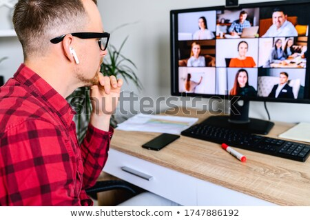 smart casual man wearing glasses touching his chin stock photo © feedough