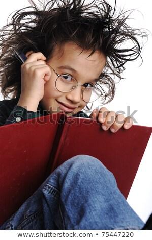 smart nerd kid with glasses and funny hair writing stock photo © zurijeta