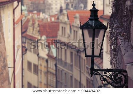 beautiful old wall lamp on a historic street near the Prague Castle Stock photo © artjazz