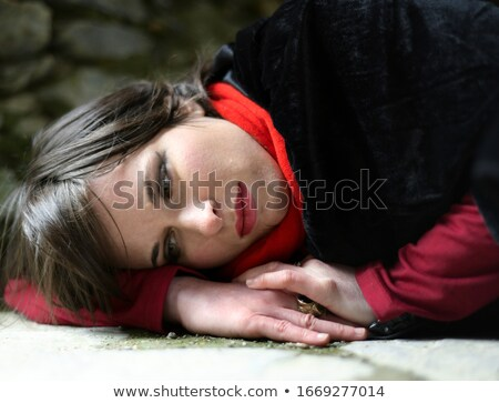 Depressed woman rests on the stone wall Stock photo © filipw