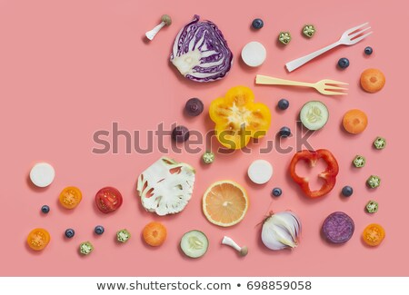 Colourful background of assorted sliced carrots Stock photo © ozgur