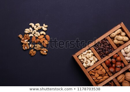 Assorted nuts in wooden box stock photo © zurijeta