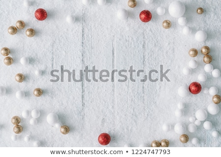 beautiful christmas ball in snow background stock photo © SArts