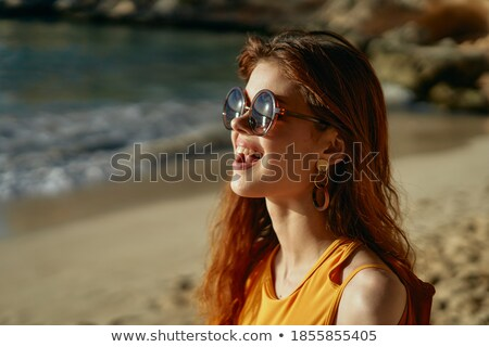 Cropped portrait of model in swimsuit stock photo © deandrobot