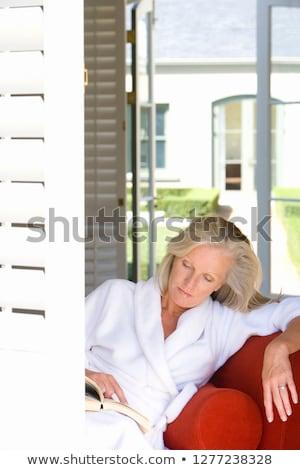 függőleges · kép · higgadt · nő · fürdőköpeny · olvas - stock fotó © deandrobot