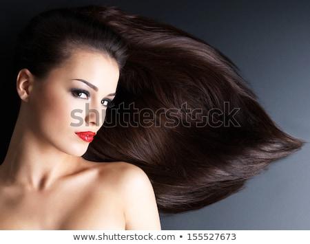 dark-haired model on floor in studio Stock photo © julenochek