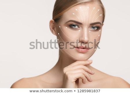 Correction lines on woman face. Stock photo © O_Lypa