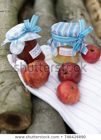 Ripe Apples and jam on log pile Stock photo © IS2