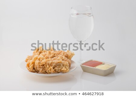 fried chicken drumsticks and wings  in a glass isolated over white background Stock photo © milsiart
