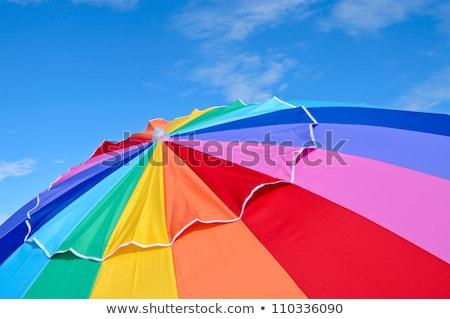 Arco-íris guarda-sol isolado branco céu Foto stock © tuulijumala